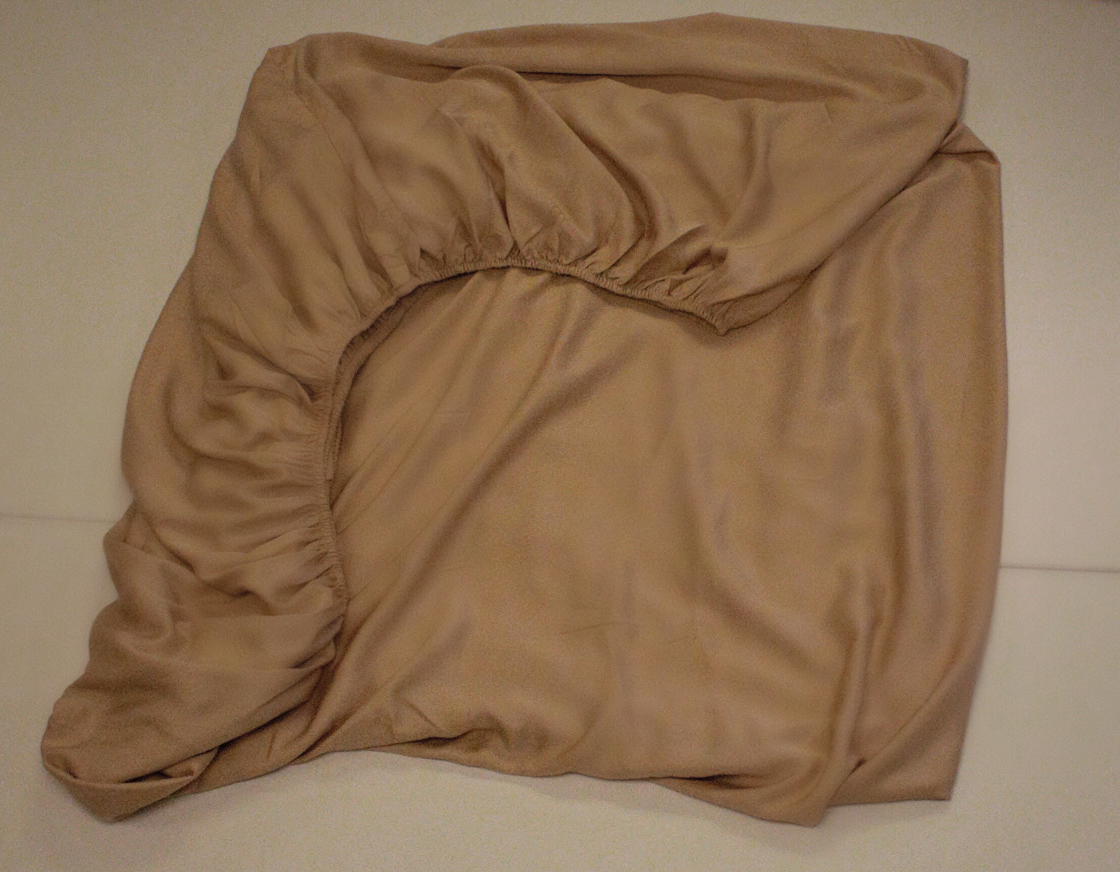 take the two elastic sides and fold them to create a straight edge once youu0027ve completed that you can begin to fold it just as you would a flat sheet - How To Fold Fitted Sheets