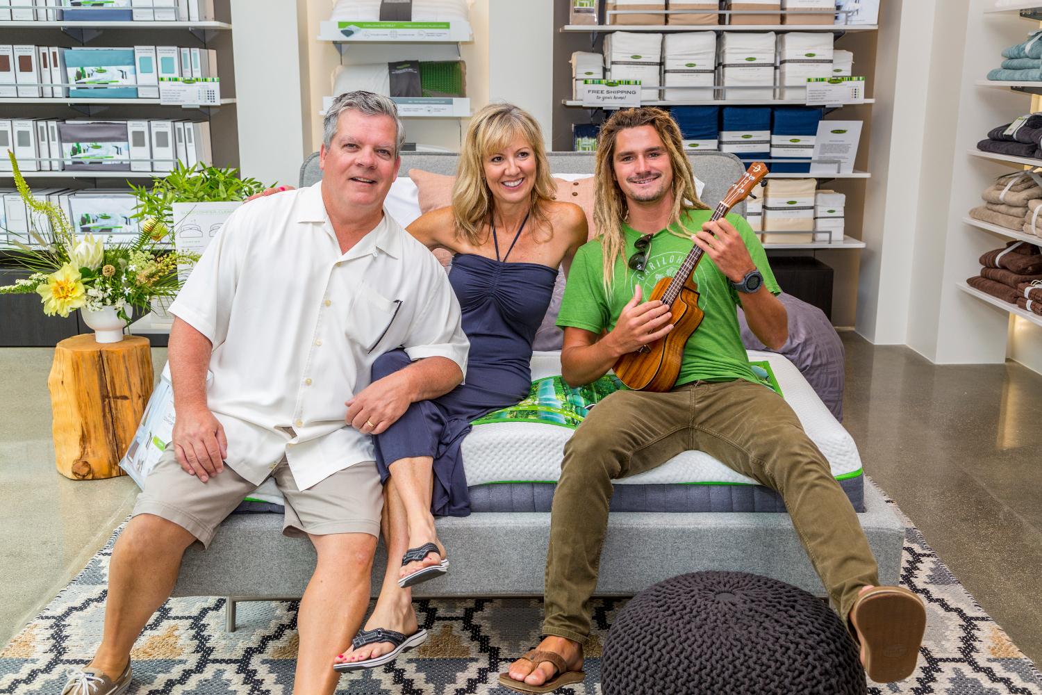 kevin and lisa long owners of cariloha in huntington beach ham it up in the store on a bamboo mattress with austin keen world champion skim boarder and